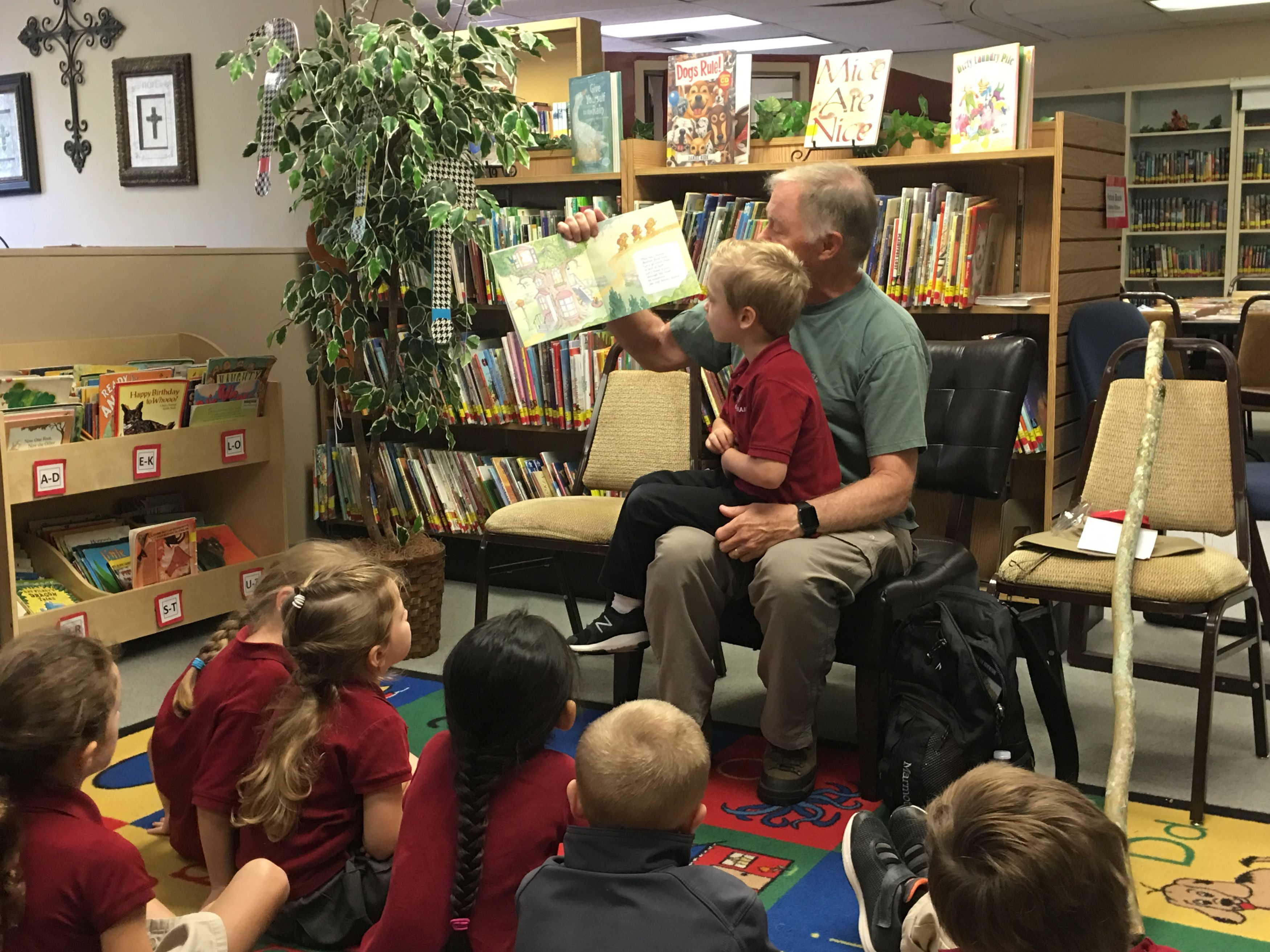 Image of parent reading to student