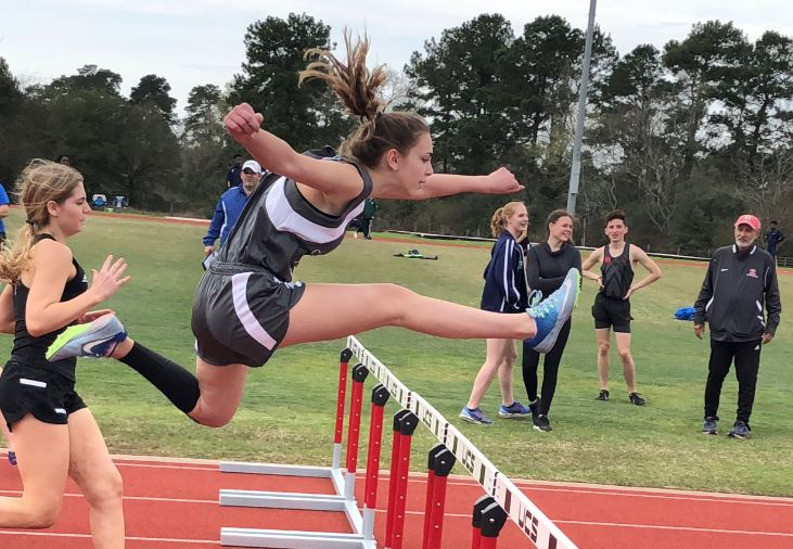 Image of high school student hurdling